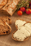 Freshly baked traditional bread with butter cream Stock Image