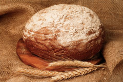 Freshly baked traditional bread on wooden board Stock Photo