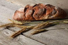 Freshly baked traditional bread on wooden table Royalty Free Stock Photography