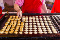 Freshly baked traditional Dutch mini pancakes called Stock Images