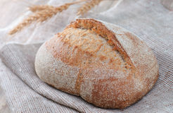 Freshly baked traditional rye bread on vintage background Royalty Free Stock Image