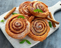 Freshly Baked Traditional Sweet Cinnamon Rolls, Swirl on white wooden board Stock Photography