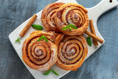 Freshly Baked Traditional Sweet Cinnamon Rolls, Swirl on white wooden board Stock Photography