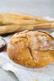 Freshly baked traditional wheat bread and wheat ears Stock Photo