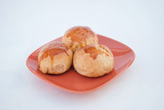 Freshly baked turkish cheese pies. On a orange plate Royalty Free Stock Photography