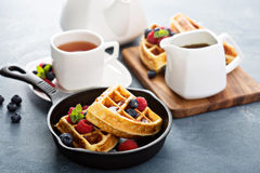 Freshly baked waffles with berries for breakfast Stock Photography