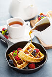 Freshly baked waffles with berries for breakfast Stock Photos