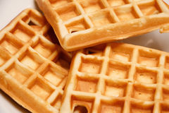 Freshly baked waffles. On a white plate Stock Image