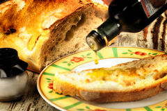 Freshly baked white bread with olive oil Royalty Free Stock Photo