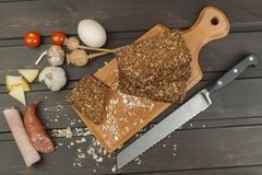 Freshly baked whole wheat bread. Preparing homemade breakfast. Various ingredients for the meal. Stock Photo