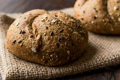 Freshly Baked Whole Wheat Grain Kaiser Roll Round Breads with Sack. Stock Image