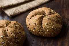 Freshly Baked Whole Wheat Grain Kaiser Roll Round Breads with Sack. Stock Photography