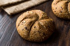 Freshly Baked Whole Wheat Grain Kaiser Roll Round Breads with Sack. Royalty Free Stock Images