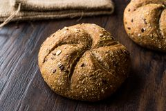 Freshly Baked Whole Wheat Grain Kaiser Roll Round Breads with Sack. Royalty Free Stock Image