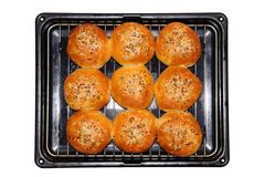 Wholemeal rolls on cooling rack. Royalty Free Stock Photo