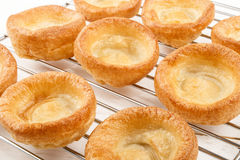 Freshly baked yorkshire pudding on a cooling rack Royalty Free Stock Photography
