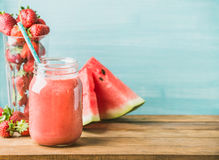 Freshly blended red fruit smoothie in glass jar with straw Stock Photos