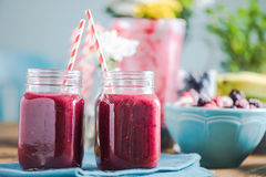 Freshly blended smoothie, in sunny kitchen. Copy space. Freshly blended smoothie, in sunny kitchen on farmhouse table. Negative space for text, ingredients and Stock Photo