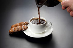 Freshly brewed black coffee from the turks poured in a white Cup Stock Photo
