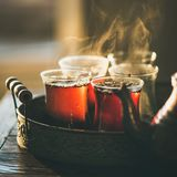 Freshly brewed black tea in turkish glasses, square crop. Freshly brewed black tea in turkish glasses in oriental tray, selective focus, copy space, square crop Royalty Free Stock Image