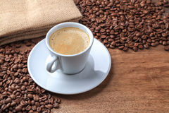 Freshly brewed coffee background. Closeup of  freshly brewed coffee on the old wood background Stock Image