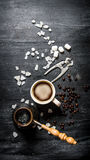 Freshly brewed coffee with crystalline sugar. Royalty Free Stock Images