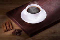 Freshly brewed coffee. Coffee cup and saucer on a wooden table Royalty Free Stock Photography