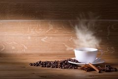 Freshly brewed coffee. Coffee cup and saucer on a wooden table. Oak background Stock Photo