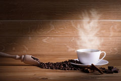 Freshly brewed coffee. Coffee cup and saucer on a wooden table. Oak background Royalty Free Stock Image