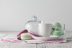 Freshly brewed coffee with delicious macarons. Stock Image