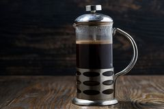 Freshly brewed coffee in the french press. Closeup Royalty Free Stock Images