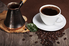 Freshly brewed coffee. Fresh and fragrant coffee with beans Royalty Free Stock Images