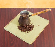 Freshly brewed coffee in old coffee pot and coffee beans Stock Photo