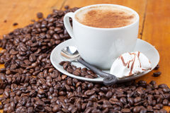 Freshly brewed cup of coffee served with meringue Royalty Free Stock Photo