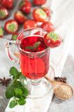Freshly brewed cup of strawberry tea with fresh mint. Royalty Free Stock Photo