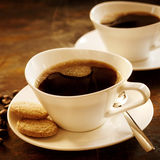 Freshly brewed cup of strong espresso coffee Royalty Free Stock Photos