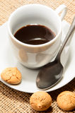 Freshly brewed espresso in a cup and biscuit Stock Image
