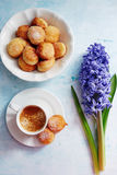 Freshly brewed espresso, small homemade doughnuts with icing sugar Royalty Free Stock Image