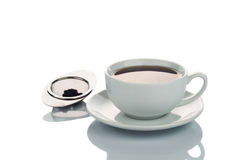Freshly brewed hot tea in cup saucer with tea sieve Stock Photography