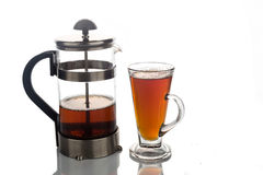 Freshly brewed hot tea in transparent glass with portafilter Stock Photos