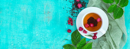 Freshly brewed tea with summer ripe berries. Top view, Banner format.  Royalty Free Stock Images