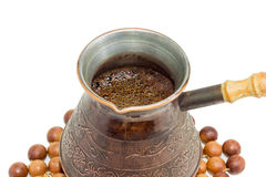 Freshly brewed Turkish coffee in old copper coffee pot closeup Royalty Free Stock Photography