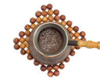 Freshly brewed Turkish coffee in old copper coffee pot Royalty Free Stock Photo
