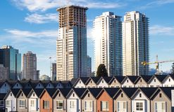 Brand new townhouses in a row on bright sunny day with Highrises in the background. Freshly build townhomes in beautifull row royalty free stock images