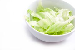 Freshly chopped lettuce in white bowl Royalty Free Stock Image