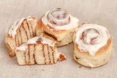 Freshly cinnabon French bun with cinnamon and cream, selective focus. Closeup Stock Photos