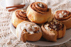 Freshly cinnamon rolls with almond close up and coffee. horizont Stock Photo