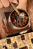 Freshly coffee beans in bowl  and coffee beans in coffee grinder Stock Photos