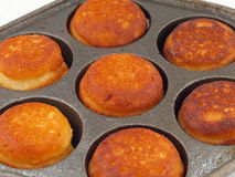 Freshly Cooked Aebelskivers Awaiting Garnish Royalty Free Stock Images
