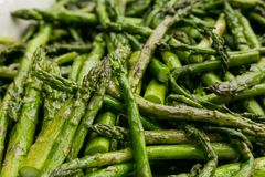 Freshly cooked asparagus for catering at a corporate event. Large bowl of freshly cooked asparagus for catering at a corporate event gala dinner banquet Royalty Free Stock Image